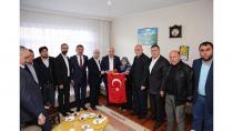Bıyık, şehit ailelerine Türk Bayrağı hediye etti